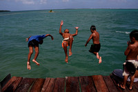 Island boys jumping off dock - Pohnpei, Micronesia